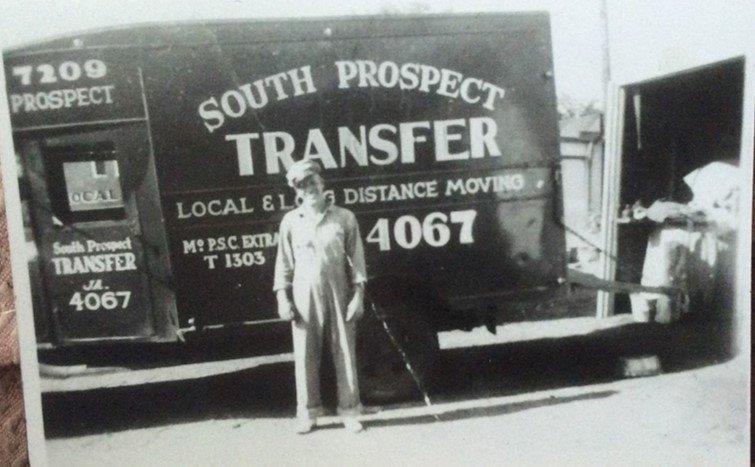 Bill Cartwright Sr in front of South Prospect Transfer Truck